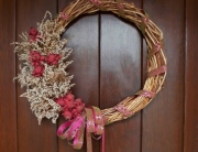 A Trumpet vine wreath decorates for season