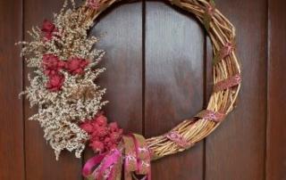 A Trumpet vine wreath decorates for season