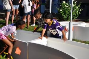 kids building kitchen community
